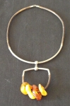 Amber Necklace with Four Wheels by Ieva  Bluķe